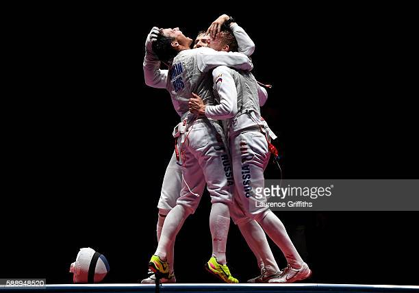 Timur Safin Alexey Cheremisinov and Artur Akhmatkhuzin of Russia celebrate after winning gold for the Men's Team Foil event on Day 7 of the Rio 2016...