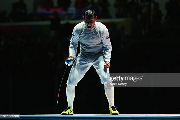 Timur Safin of Russia celebrates defeating Richard Kruse of Great Britain to win the Bronze Medal during Men's Individual Foil Finals on Day 2 of the...