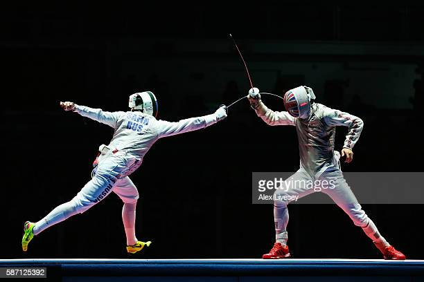 Timur Safin of Russia competes with Richard Kruse of Great Britain on his way to winning the Bronze Medal during Men's Individual Foil Finals on Day...