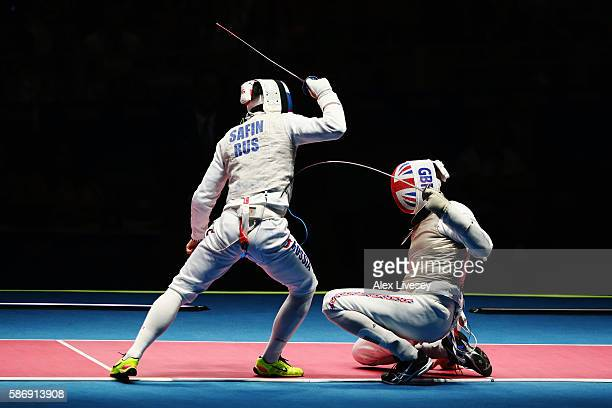 Timur Safin of Russia defeats James-Andrew Davis of Great Britain during Men's Individual Foil on Day 2 of the Rio 2016 Olympic Games at Carioca...