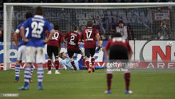 Timy Simons of Nuernberg scores a penalty goal during the Bundesliga match between 1. FC Nuernberg and FC Schalke 04 at Easy Credit Stadium on April...