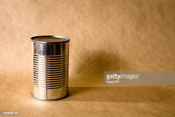 Tin can on brown paper bag type background.