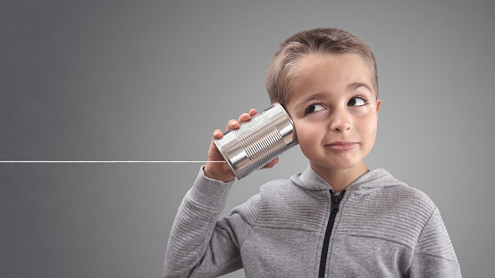 Tin can phone listening to curious good news 868429632