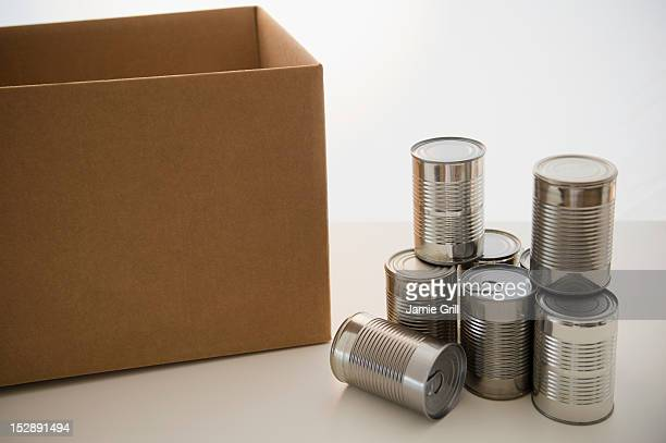 Tin cans and cardboard box