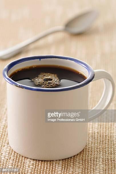 Tin cup of coffee