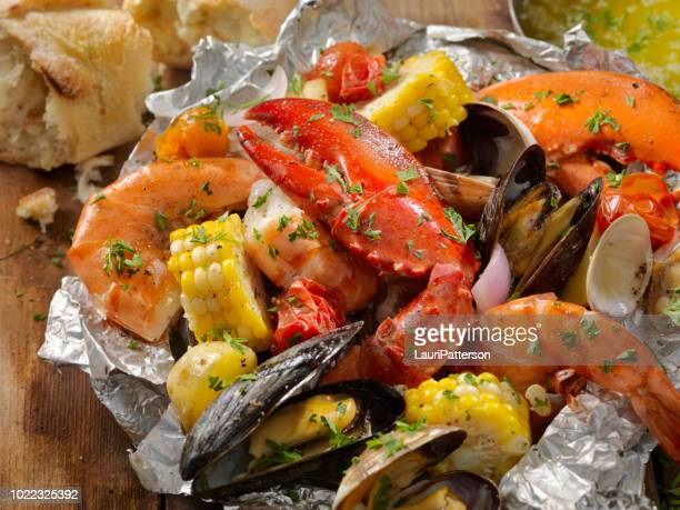 tin foil wrapped shellfish - shrimp seafood stock pictures, royalty-free photos & images