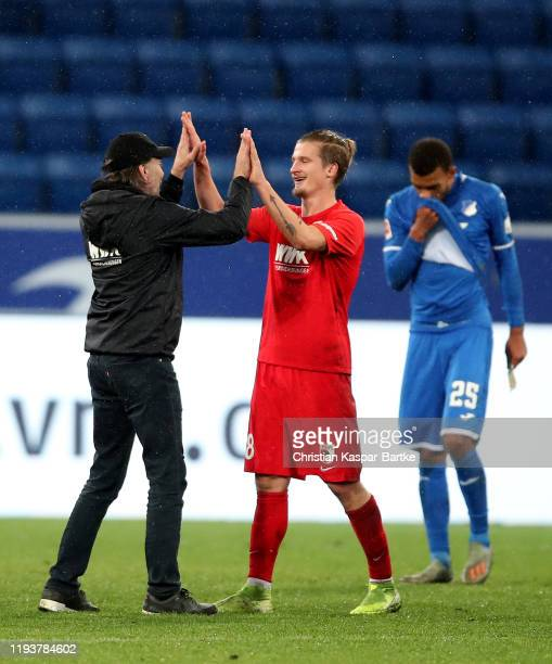 Tin Jedvaj of Augsburg is congratulated by Martin Schmidt the haed coach of Augsburg during the Bundesliga match between TSG 1899 Hoffenheim and FC...
