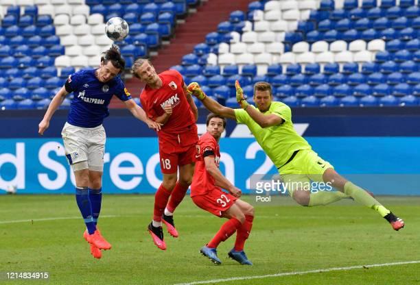 Tin Jedvaj of Augsburg saves a shot from Michael Gregoritsch of FC Schalke 04 during the Bundesliga match between FC Schalke 04 and FC Augsburg at...