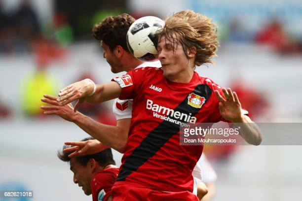 Tin Jedvaj of Bayer 04 Leverkusen challenges for the headed ball with Jonas Hector of Koeln during the Bundesliga match between Bayer 04 Leverkusen...