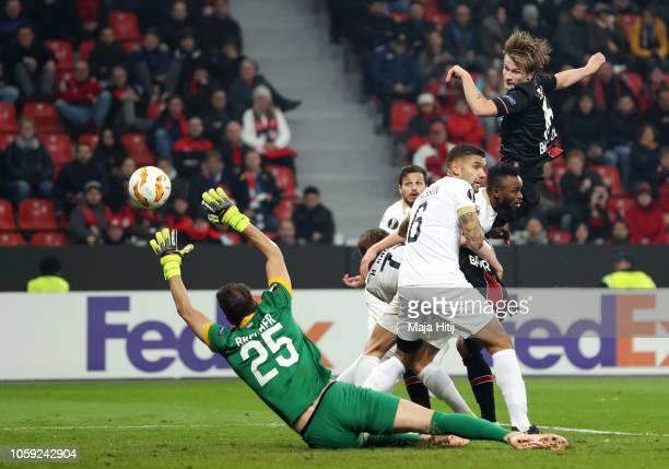 Tin Jedvaj of Bayer 04 Leverkusen scores his team's first goal past Yanick Brecher of FC Zurich during the UEFA Europa League Group A match between...