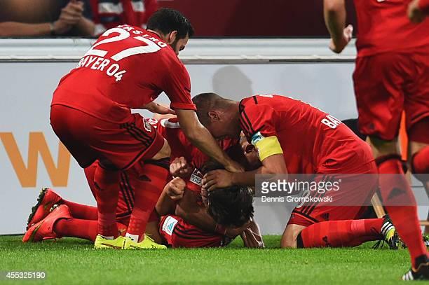 Tin Jedvaj of Bayer Leverkusen is congratulated as he scores their first goal during the Bundesliga match between Bayer 04 Leverkusen and Werder...