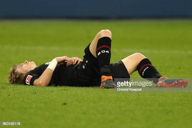 Tin Jedvaj of Bayer Leverkusen lies on the pitch dejected after the Bundesliga match between Bayer 04 Leverkusen and VfB Stuttgart at BayArena on...