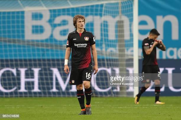 Tin Jedvaj of Bayer Leverkusen looks dejected after Stuttgart scored a goal during the Bundesliga match between Bayer 04 Leverkusen and VfB Stuttgart...