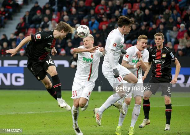 Tin Jedvaj of Bayer Leverkusen Philipp Max of FC Augsburg Michael Gregoritsch of FC Augsburg Andre Hahn of FC Augsburg and Lars Bender of Bayer...