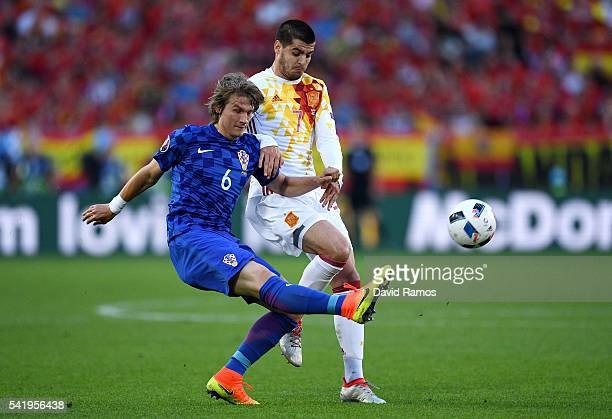 Tin Jedvaj of Croatia and Alvaro Morata of Spain compete for the ball during the UEFA EURO 2016 Group D match between Croatia and Spain at Stade...