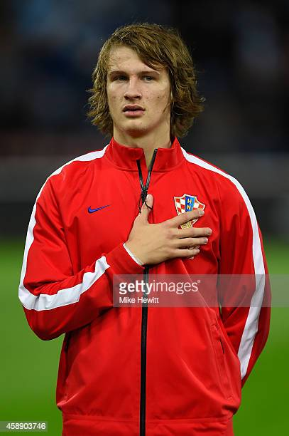 Tin Jedvaj of Croatia lines up for the National Anthems ahead of the International Friendly between Argentina and Croatia at Boleyn Ground on...