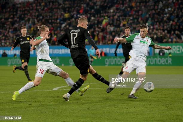 Tin Jedvaj of FC Augsburg Erling Braut Haaland of Borussia Dortmund and Jeffrey Gouweleeuw of FC Augsburg scores his team's fifth goal during the...