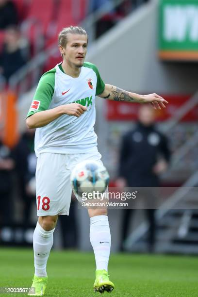 Tin Jedvaj of FC Augsburg plays the ball during the Bundesliga match between FC Augsburg and Borussia Dortmund at WWK-Arena on January 18, 2020 in...