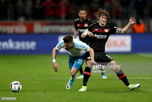 Tin Jedvaj of Leverkusen and Daniel Caligiuri of Schalke battle for the ball during the Bundesliga match between Bayer 04 Leverkusen and FC Schalke...