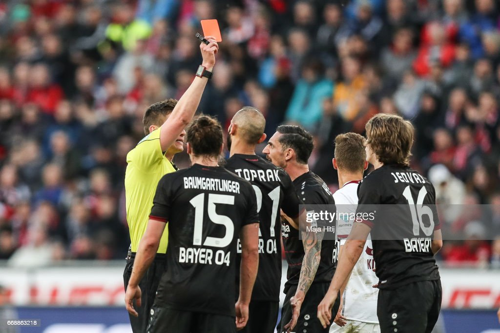 Tin Jedvaj of Leverkusen is shown a red card by referee during the Bundesliga match between Bayer 04 Leverkusen and Bayern Muenchen at BayArena on April 15, 2017 in Leverkusen, Germany.