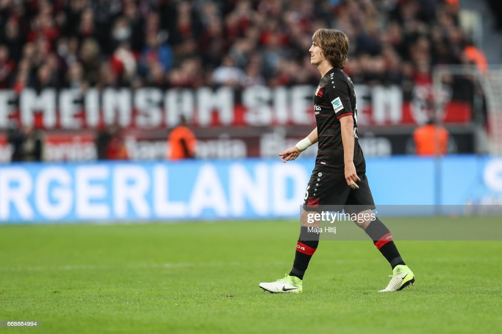 Tin Jedvaj of Leverkusen walks off the pitch after receiving a red card from referee during the Bundesliga match between Bayer 04 Leverkusen and Bayern Muenchen at BayArena on April 15, 2017 in Leverkusen, Germany.