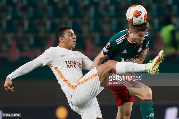 Tin Jedvaj of Lokomotiv Moscow and Mostafa Mohamed of Galatasaray vie for the ball during the UEFA Europa League Group E football match between FC...