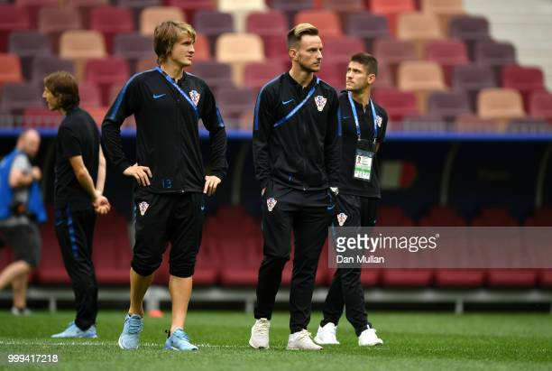 Tin Jedvaj speaks with Ivan Rakitic of Croatia during a pitch inspection prior to the 2018 FIFA World Cup Final between France and Croatia at...