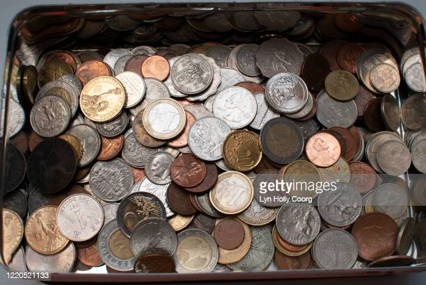tin money box of coins of various currency - lyn holly coorg stock pictures, royalty-free photos & images