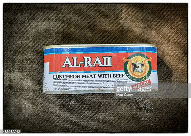 A tin of halal meat is seen after it was discarded beside railway tracks that run from Serbia into Hungary and is used by migrants to enter illegally...