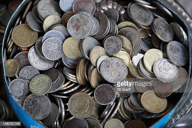 A tin of old Drachma coins for sale in a junk shop on June 13 2012 in Athens Greece The Greek electorate are due to go to the polls in a rerun of the...