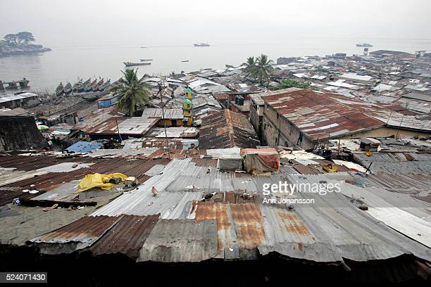 Tin roofs cover homes in Susan's Bay slum in Freetown Sierra Leone November 16 2008