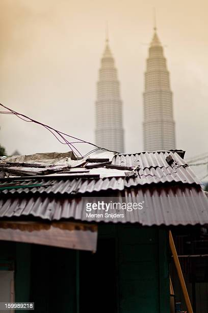 tin roofs in front of petronas towers - merten snijders stock pictures, royalty-free photos & images