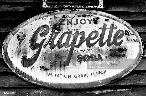 A tin sign advertising Grapette Soda nailed near the entrance of an abandoned country store near Abingdon in the Appalachian Mountains of Southwest...