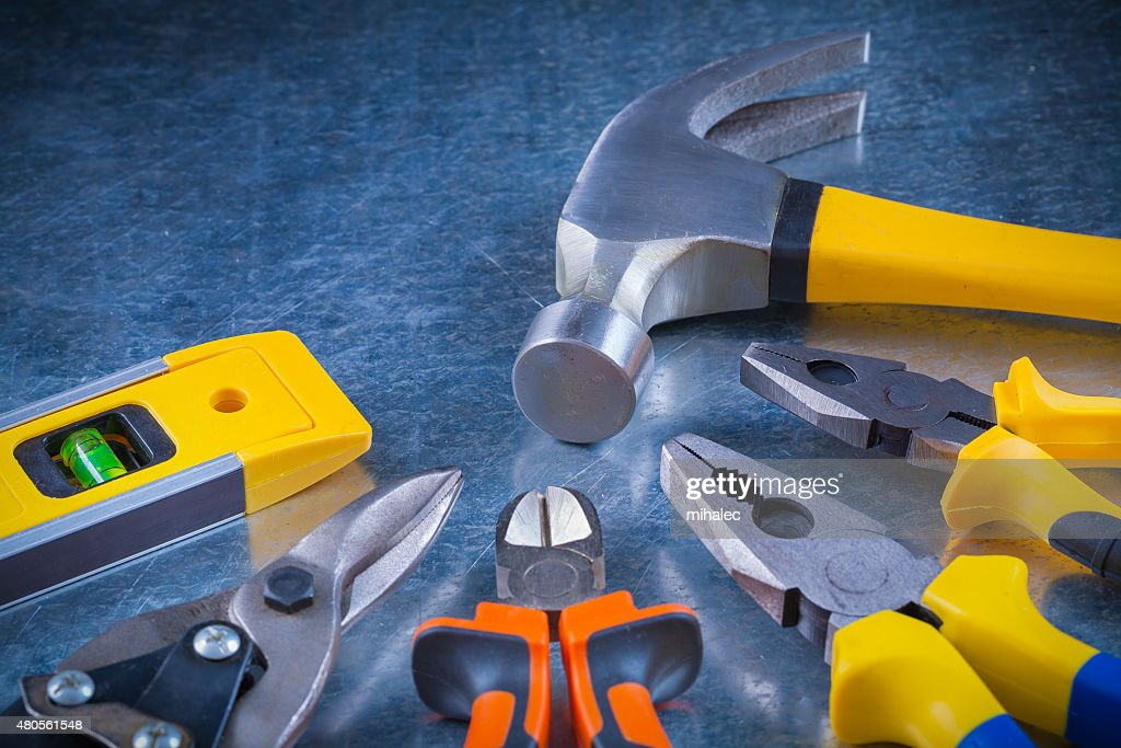 Tin snips gripping tongs nippers hammer and construction level o : Stock Photo