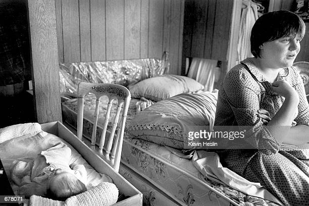 Tina a seventeen year old mother sits and thinks about her situation as her newborn son Wayne Jr lies in the top drawer of her dresser in her bedroom...
