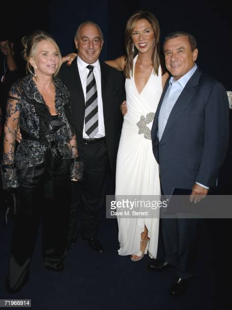 Tina and Philip Green with Heather and Sol Kerzner attend the fashion show and party to celebrate the launch of Emporio Armani RED collection at...