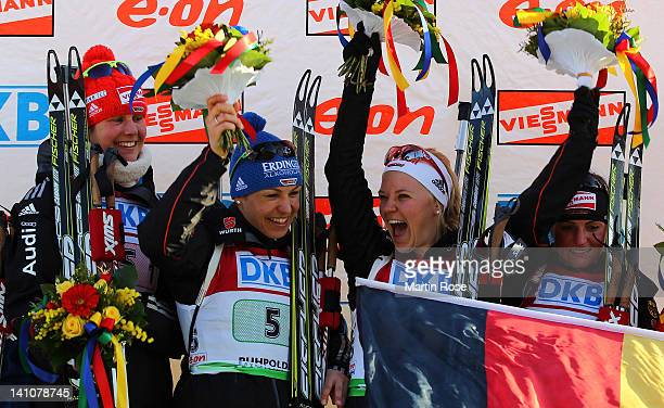 Tina Bachmann, Magdalena Neuner, Miriam Goessner and Andrea Henkel of Germany celebrate their gold medal in the Women's 4 x 6km Relay during the IBU...