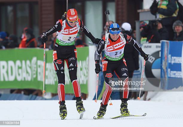Tina Bachmann of Germany hands over to her team mate Magdalena Neuner at the women's relay during the IBU Biathlon World Championships at AV...