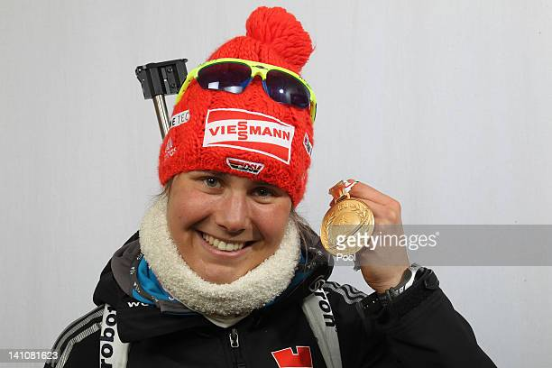 Tina Bachmann of Germany shows her medal of the Women's 4 x 6km Relay during the IBU Biathlon World Championships at Chiemgau Arena on March 10, 2012...