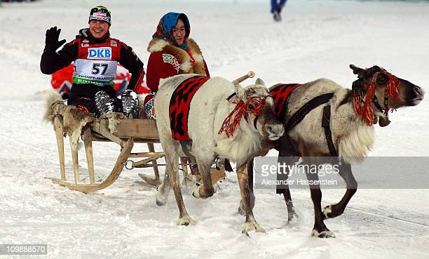 Tina Bachmann of Germany smiles on the victory lap on reindeer sleighs prior the medal ceremony of the women's 15km individual race during the IBU...