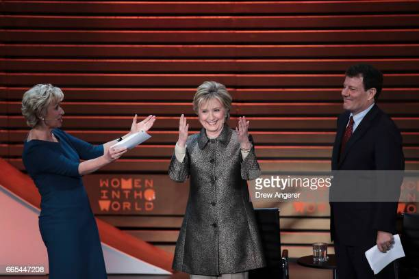 Tina Brown acknowledges former US Secretary of State Hillary Clinton after an interview with Nicholas Kristof during the Women in the World Summit at...