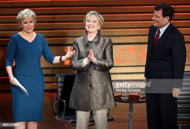 Tina Brown former United States Secretary of State Hillary Clinton and journalist Nicholas Kristof speak on stage at the 8th Annual Women In The...