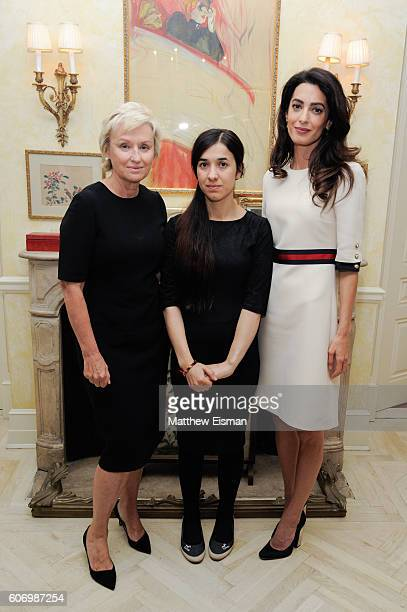 Tina Brown Nadia Basee Taha and Amal Clooney attend the Women In The World reception honoring appointment of UN Office on Drugs and Crime Goodwill...