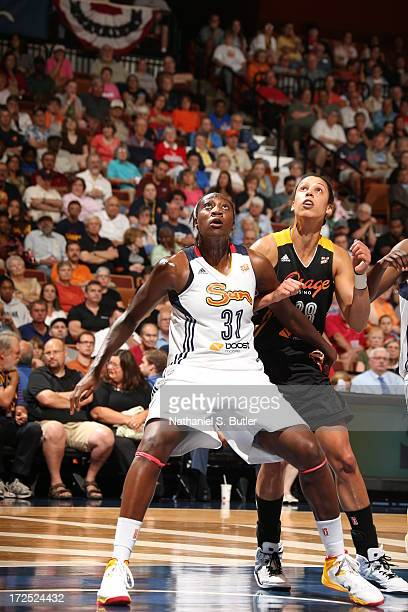 Tina Chalres of the Connecticut Sun boxes out Nicole Powell of the Tulsa Shock during a game on July 2 2013 at the Mohegan Sun Arena in Uncasville...