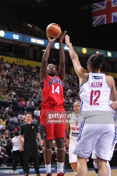Tina Charles of the 2012 US Women's Senior National Team shoots during an exhibition game against Great Britain's Women's team at the Manchester...