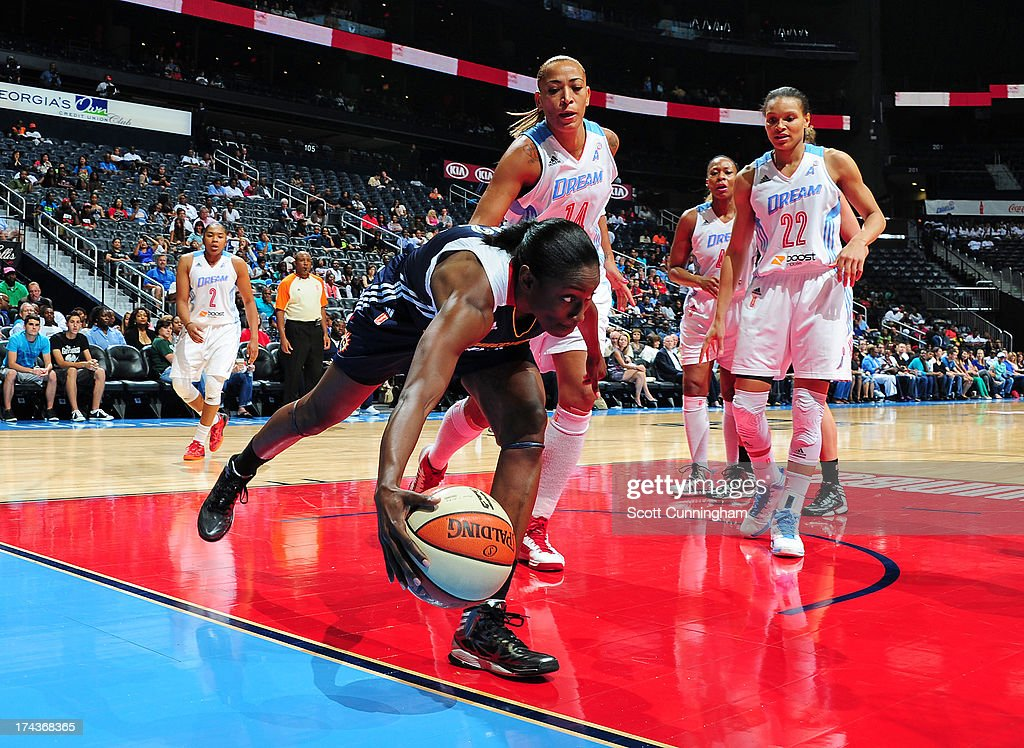 Tina Charles #31 of the Connecticut Sun attempts to save the ball against the Atlanta Dream at Philips Arena on July 24, 2013 in Atlanta, Georgia.