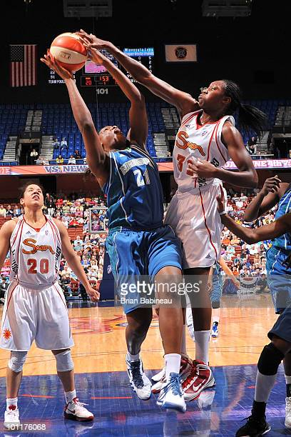 Tina Charles of the Connecticut Sun blocks Nicky Anosike of the Minnesota Lynx on May 27 2010 at the Mohegan Sun Arena in Uncasville Connecticut NOTE...