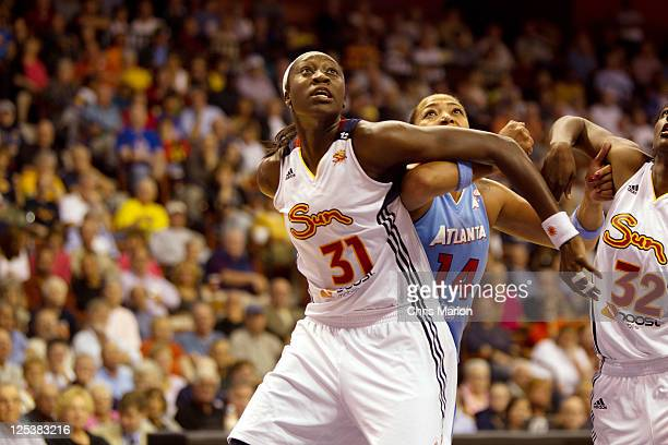 Tina Charles of the Connecticut Sun boxes out Erika de Souza of the Atlanta Dream in Game One of the Eastern Conference Semifinals during the 2011...