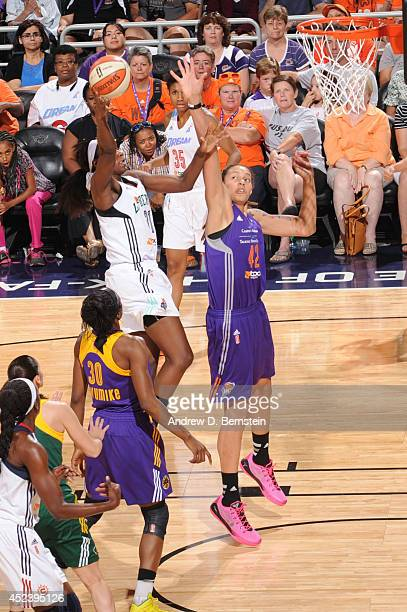 Tina Charles of the Eastern Conference AllStars shoots against Brittney Griner of the Western Conference AllStars during the 2014 Boost Mobile WNBA...