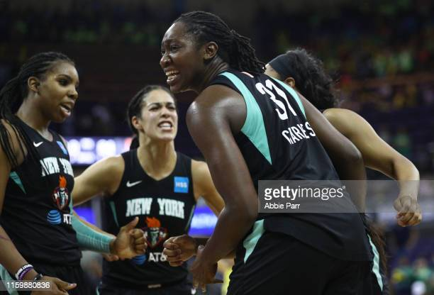 Tina Charles of the New York Liberty celebrates with teammates after their 84-83 win against the Seattle Storm during their game at Alaska Airlines...